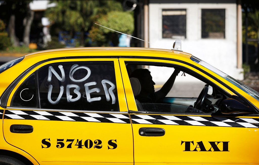 A taxi drivers takes part in a demonstration in San Salvador