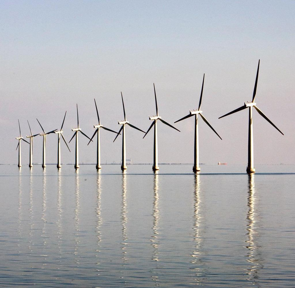 FILE-PHOTO-An-off-shore-wind-farm-stands-in-the-water-near-the-Danish-island-of