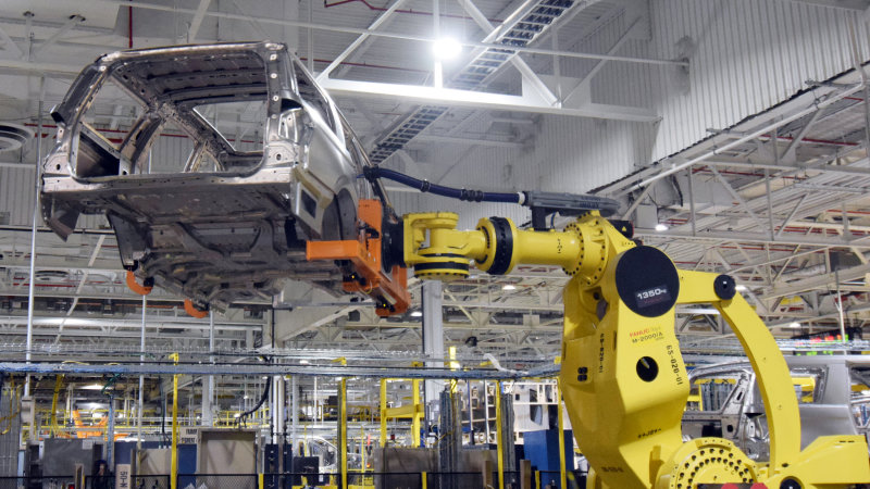 A large robot nicknamed ÒKongÓ lifts the body of a Ford Expedition SUV at FordÕs Kentucky Truck Plant in Louisville