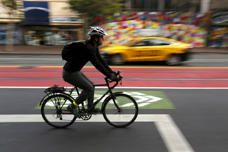 A cyclist rides bike lane in the Mid Market neighborhood during Bike to Work Day  in San Francisco